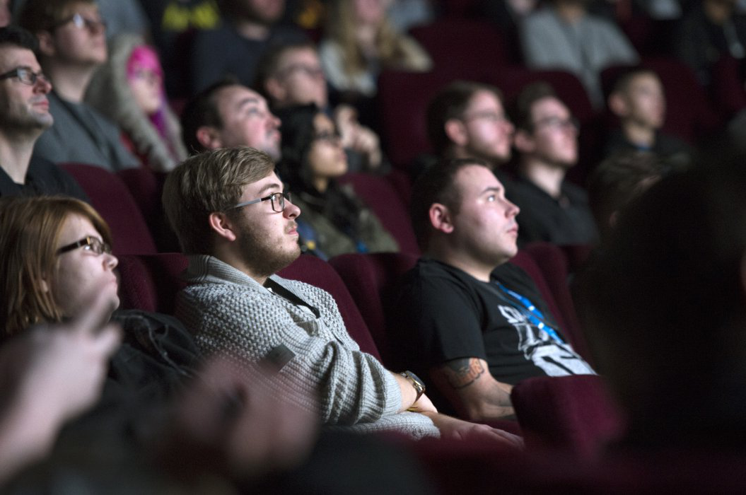 Image shows audience members looking at the screen during a pictureville影院 event