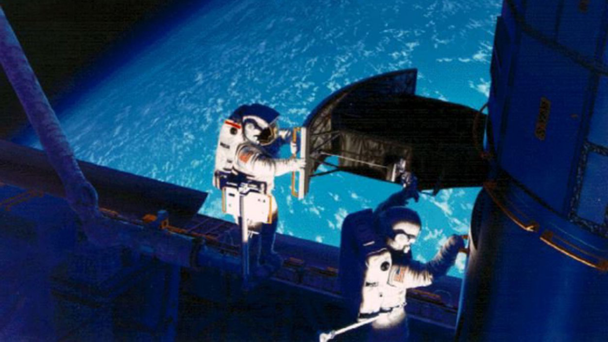 Astronauts Jeffrey Hoffman and Story Musgrave install the Wide Field and Planetary Camera 2 on the Hubble Space Telescope